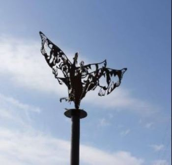 A metal sculpture of two eagles tangled in flight named Lovers, Fighters
